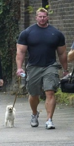 Large man little dog.