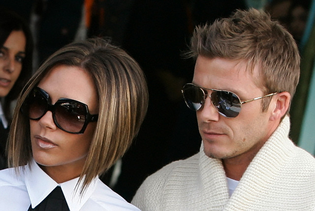 17 Nov 2006, Rome, Italy --- David and Victoria Beckham arrive at Rome's Ciampino airport to attend the wedding of Katie Holmes and Tom Cruise. --- Image by © Tony Gentile/Reuters/Corbis